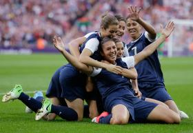 United States' Carli Lloyd, right, celebrates with teammates after scoring during the women's soccer gold medal match against Japan at the 2012 Summer Olympics, in London.