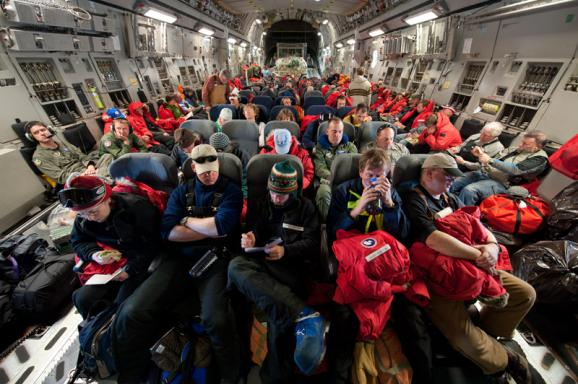 Scientists and their gear travel to Antarctica in the belly of an Air Force C-17 transport plane.