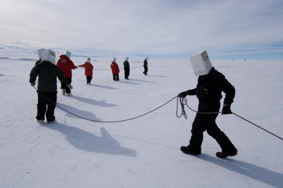 """Happy Camper"" training at Antarctica's McMurdo Station includes simulating a rescue operation in white-out conditions."
