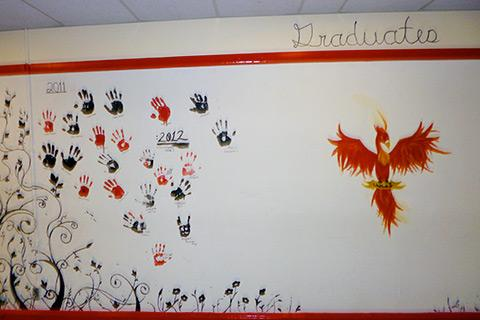 Graduates of the B. B. Russell School put their handprints on the wall to inspire other students.