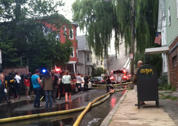 Emergency personnel on the scene of a 7-alarm fire on Calvin St. in Somerville Thursday morning.