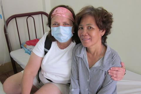 Professor Rosanna DeMarco with a patient in the Ho Chi Minh City clinic.