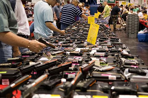 Potential buyers browse at a gun show in Houston, Texas., gun control, 2nd amendment