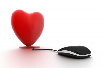 A computer mouse attached to a heart