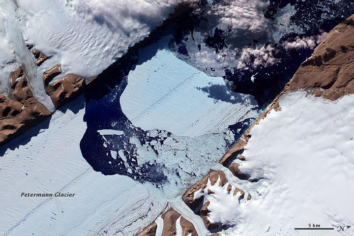 A 12-square-mile ice island breaks from the Petermann Glacier in Greenland. While these events occur naturally, scientists have noticed that the breaks are happening farther up the glacier.