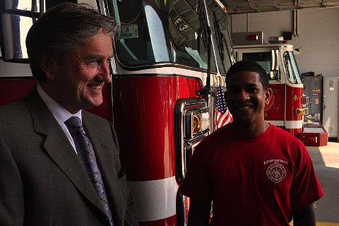 Rep. John Tierney talks with firefighters in Lynn, Mass.