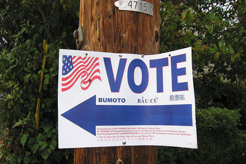 A sign pointing to a polling location