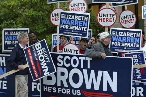 Supporters of Republican U.S. Sen. Scott Brown, R-Mass., carry campaign signs past supporters of Democratic challenger Elizabeth Warren prior to a debate sponsored by the Boston Herald at the University of Massachusetts in Lowell, Mass., Monday, Oct. 1, 2
