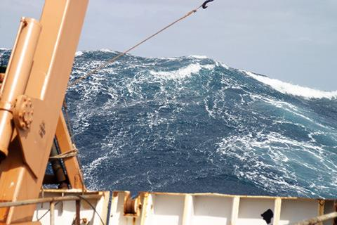 A large wave towering astern of the NOAA Ship DELAWARE II. Atlantic Ocean, New England Seamount Chain, 2005.