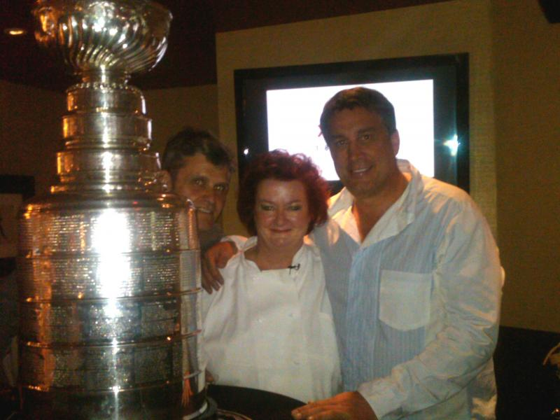 Patrick Lyons, Lydia Shire and Cam Neely with the Stanley Cup