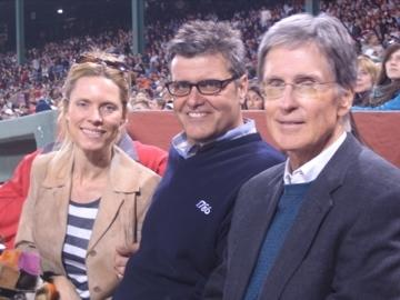 Patrick Lyons with his wife Kristina Lyons and John Henry catching a Red Sox game