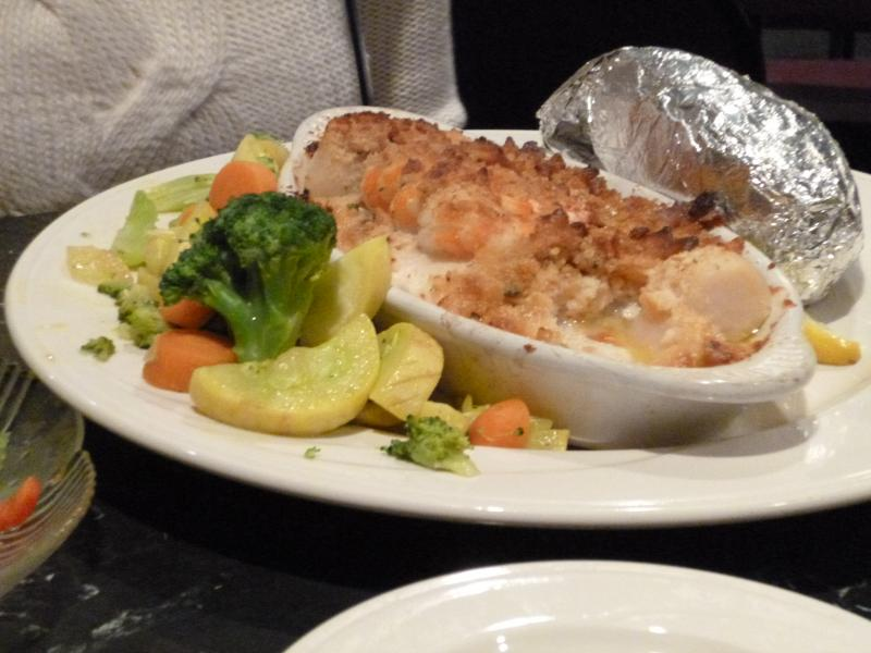 One popular dish: seafood casserole, with a baked potato and veggies - served before the entertainment begins.