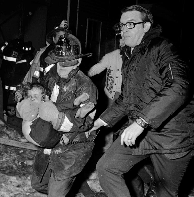 Fireman rescue Tammi Brownlee from a burning building in South Boston, 1977.