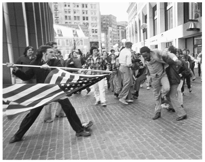 The flag turns into a weapon in fight outside City Hall during the busing riots in 1976. Forman won a Pulitzer Prize for for this photograph.