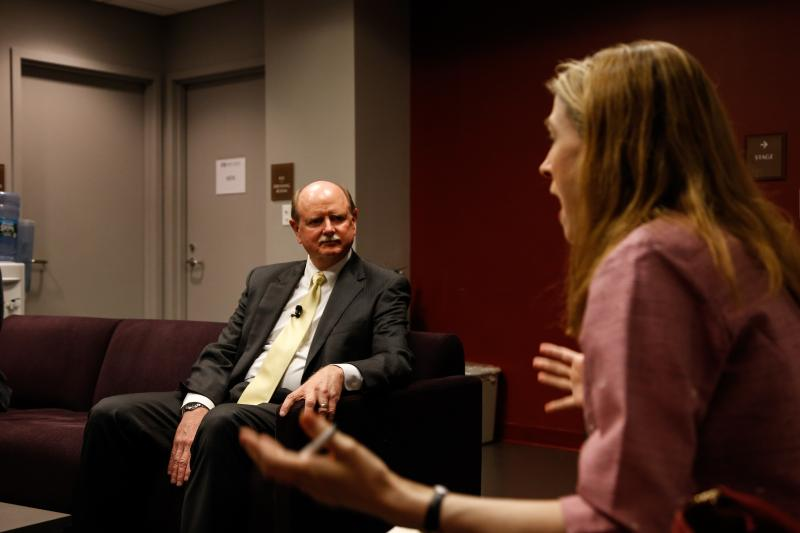Richard Miller, President of Olin College, talks with Kara Miller of Innovation Hub backstage at the Modern Theater.