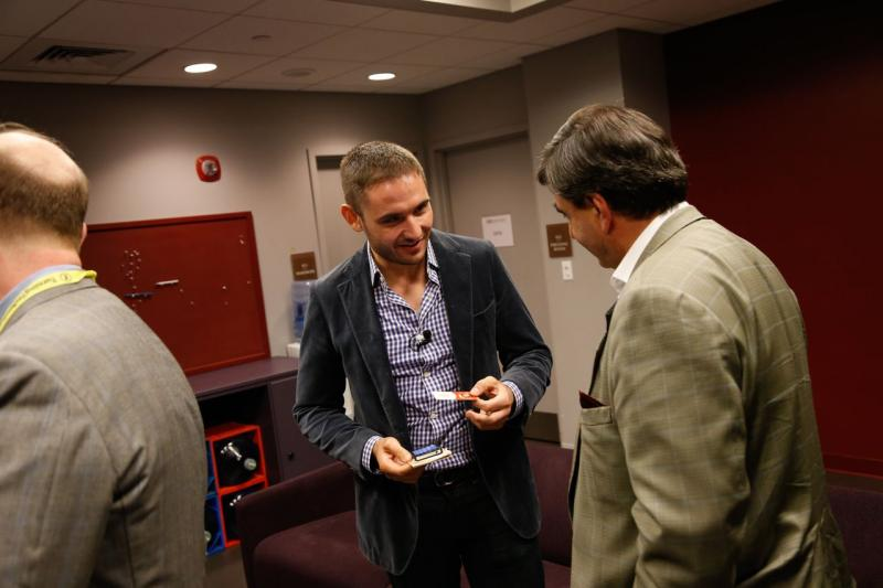 Peter Hopkins of Big Think, left, talks with Eric Mazur of Harvard backstage at the Modern Theater.