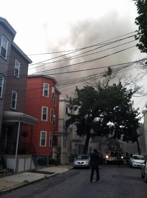Smoke is seen from a fire on Calvin Street in Somerville.