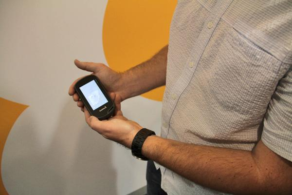 Ben Saren of Sure Shot Labs holds the Garmin Oregon 600 Handheld GPS Device in our studios in Brighton, MA.