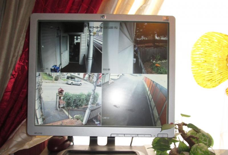 A computer screen shows feeds from security cameras in Soun's house.