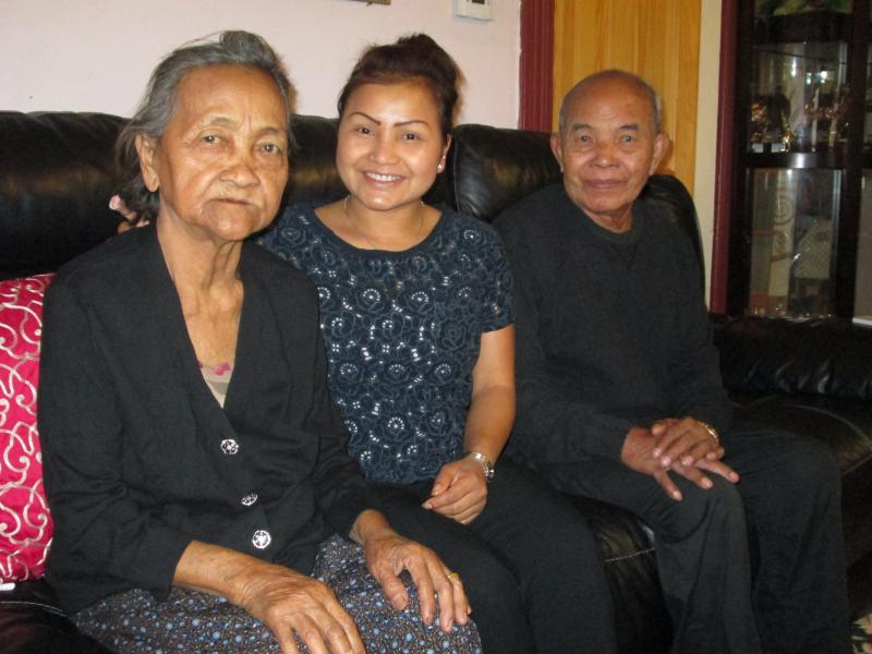 Chantha Soun, center, with her parents, Svay Moul, 78, left, and Yarm Yin, 84, right, whom she takes care of in Lowell.