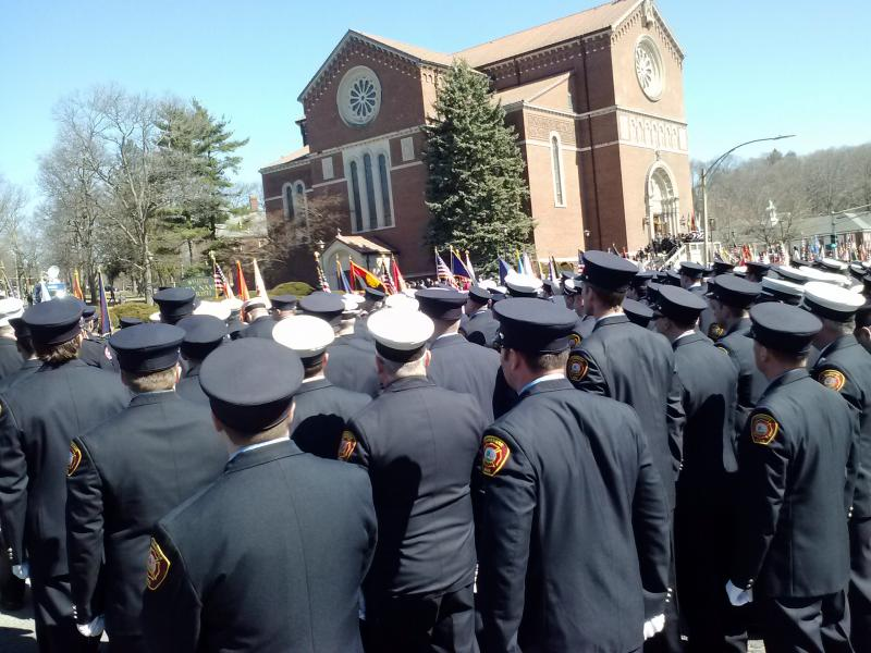 Firefighters awaited the arrival of Michael Kennedy's funeral procession at Holy Name Church in Boston, Thursday, April 3, 2014.