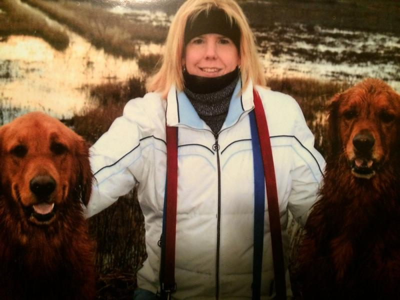 Kimberly Parker, 45, of East Bridgewater, with the two Golden Retrievers she referred to as her boys.