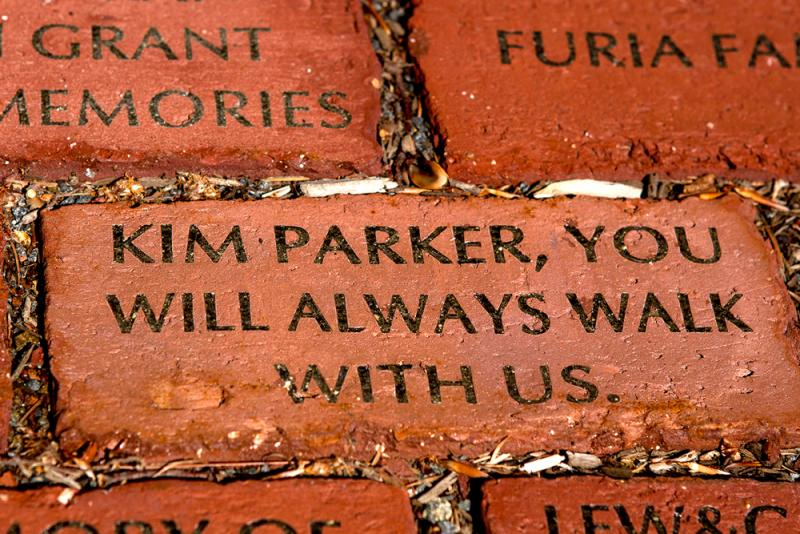 The friends of Kimberly Parker placed a brick in her memory at the Sachem Rock Farm in East Bridgewater, where Kimberly would walk her two Golden Retrievers.