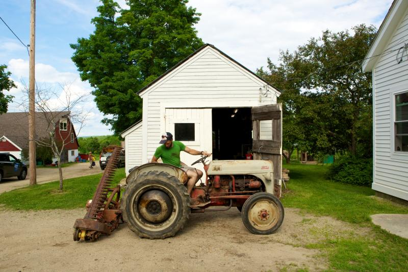 Students at the Farm School learn how to fix farm machinery.