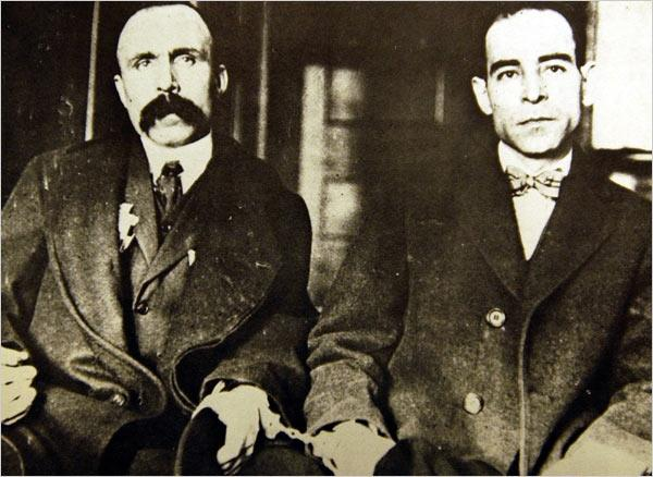 Bartolomeo Vanzetti (left), handcuffed to Nicola Sacco in Dedham Superior Court, 1923.