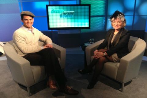 Jared Bowen and Emily Rooney sport hats on the set of Greater Boston.