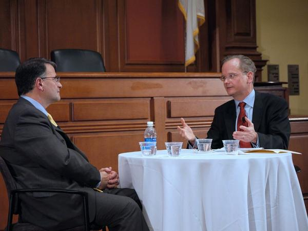 Lawrence Lessig (right) speaks to Jack Abramoff, a former lobbyist who is helping to expose Washington's legal corruption.