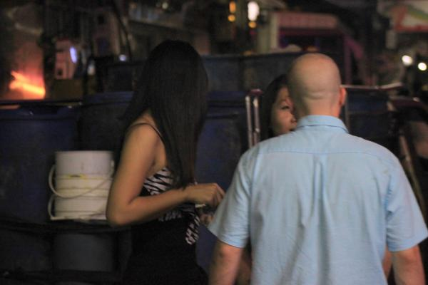 Negotiating sex on the streets of Pattaya.