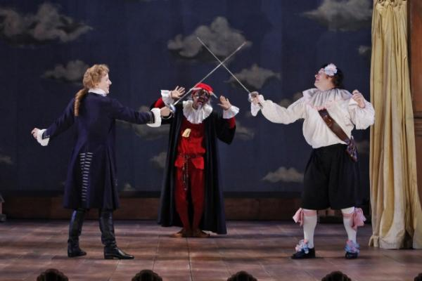 Sarah Agnew and Andy Grotelueschen (front), Allen Gilmore (background) in ArtsEmerson's production of The Servant of Two Masters.