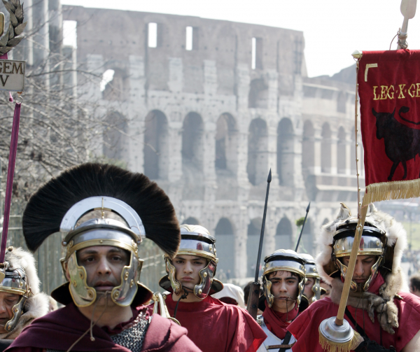 People wearing Roman centurion costumes march in front of the Colosseum on the occasion of Ides of March, in Rome, Thursday, March 15, 2007.