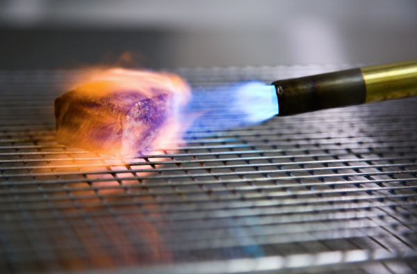 Searing with a blowtorch.