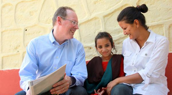 Paul Farmer with a patient in Nepal.