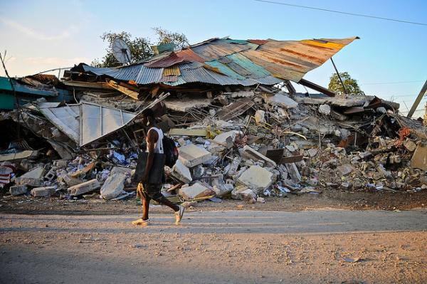 This image of Haiti shows destruction wrought by the 2010 earthquake. Farmer argues that such damage requires a long term commitment to the country.