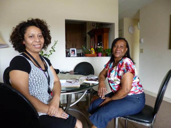 Community health worker Dieka OGarro visits Carmen Valera at home in Brockton.