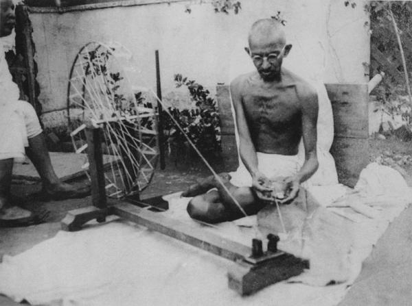 You might not be as charitable as Mohandas Gandhi - pictured here making homespun cloth in the 1920s - and that's okay, says Grant. Sometimes the favors that make the biggest difference only take five minutes.