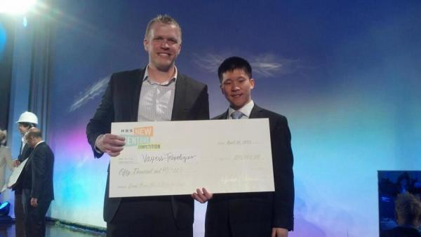 CEO of Vaxess Technologies Michael Schrader, left, poses with co-founder Patrick Ho holding their prize from the Harvard Business School's 2013 New Venture Competition.