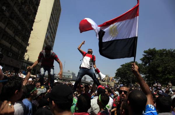 Supporters of Egypt's ousted President Mohammed Morsi chant slogans during a protest in Ramses Square in downtown Cairo, Egypt, Friday, Aug. 16, 2013. Heavy gunfire rang out Friday throughout Cairo as tens of thousands of Muslim Brotherhood supporters cla
