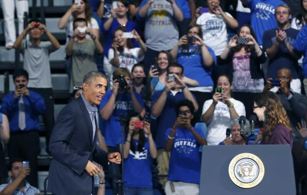 President Barack Obama is cheered as he arrives to speak at the University at Buffalo, the State University of New York, Thursday, Aug. 22, 2013 in Buffalo, N.Y., where he began his two day bus tour to speak about college financial aid.
