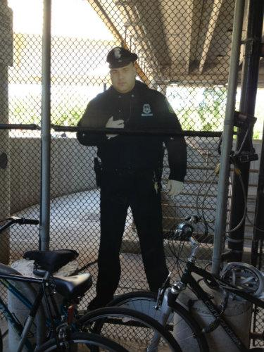 A cardboard cutout of an MBTA police officer has reduced bike thefts at Alewife Station. Feel safer?