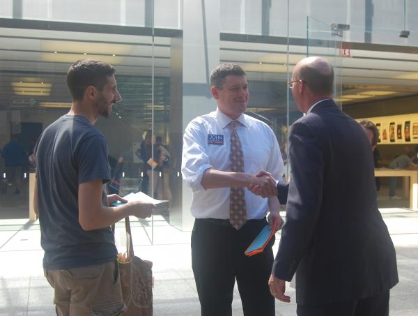 City councilor John Connolly campaigns in front of the Apple Store on Boylston Street.