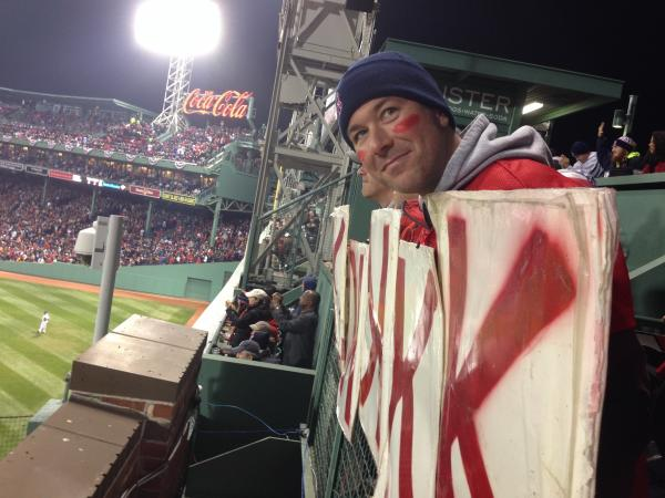 K-Men co-founder Ryan McCarthy posting K signs on the Green Monster.