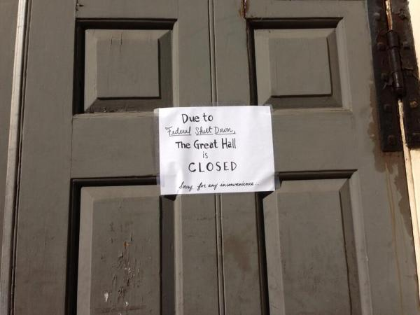 A sign posted on the door of the Great Hall at Faneuil Hall.