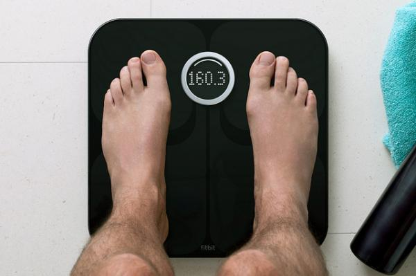 The Fitbit Aria Smart Scale introduces smart computing to the typical bathroom scale.
