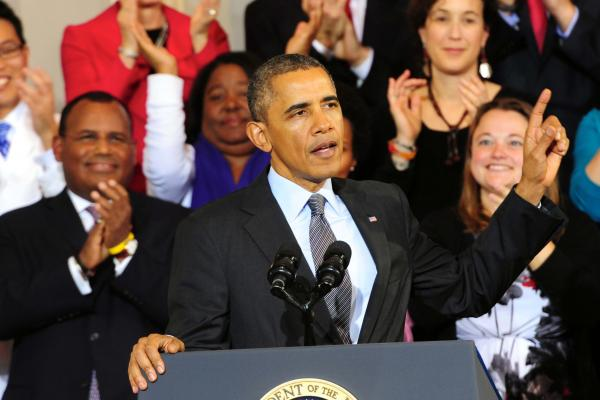 President Obama touted the Affordable Care Act to hundreds of supporters at Faneuil Hall in Boston on Oct. 30.