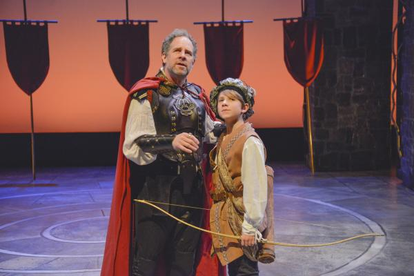 "Benjamin Evett, left, plays King Arthur; and Dashiell Evett, right, plays Tom of Warwick, in the New Repertory Theatre's production of ""Camelot."""