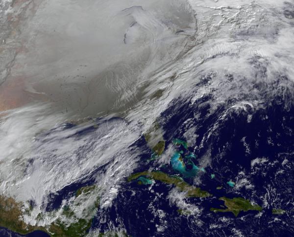 This image captured by NOAA's GOES-East satellite on Jan. 6, 2014, at 11:01 a.m. EST shows a frontal system that is draped from north to south along the U.S. East Coast. Behind the front lies the clearer skies bitter cold air associated with the polar vor